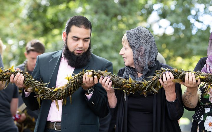 Shagaf Khan and Christchurch Mayor Lianne Dalziel during the handover of a lei at the Al Noor Mosque