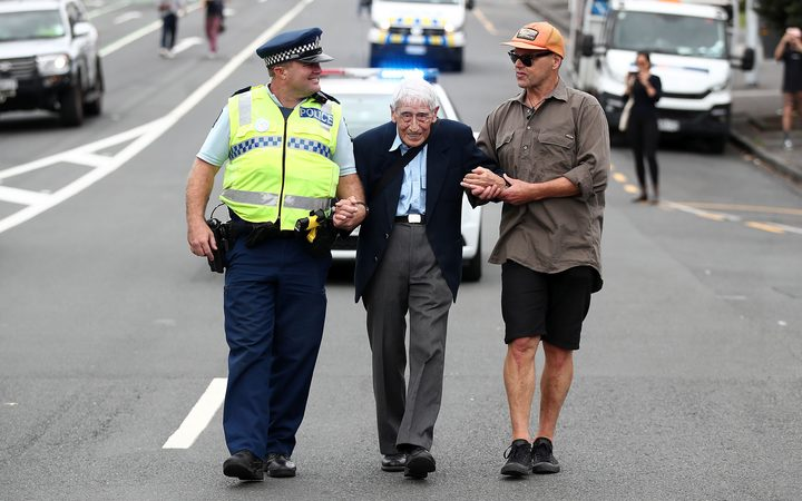 John Sato (C) 95, one of only two Japanese servicemen in the New Zealand army in WWII, took multiple buses from Howick to join the march against racism at Aotea Square.