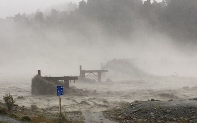 The Waiho Bridge has been totally taken out by the raging floodwaters.