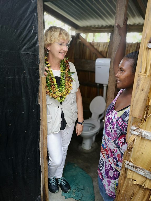 UNICEF Regional Director, Karin Hulshof in Walo community, North Malaita with a local woman.