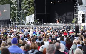 Audience listens to Yusuf Islam/ Cat Stevens perform at Hagley Park in Christchurch
