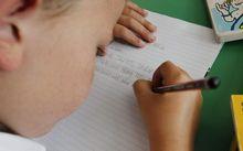 child writing at school