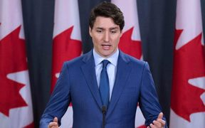 (FILES) In this file photo taken on March 07, 2019 Canadian Prime Minister Justin Trudeau speaks to the media at the national press gallery in Ottawa, Ontario. -