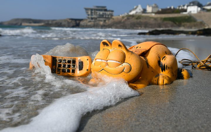 A plastic 'Garfield' phone is displayed on the beach in Le Conquet, western France