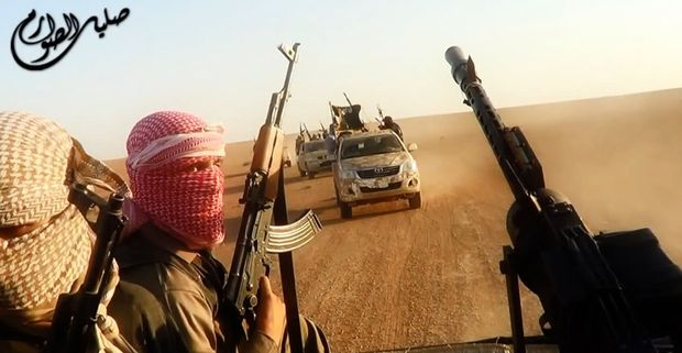 An image taken from a video uploaded to the internet by ISIS allegedly shows them driving in vehicles near the central Iraqi city of Tikrit.