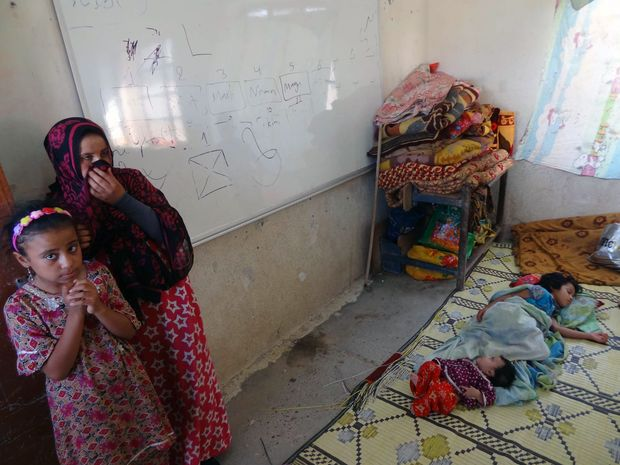 Displaced Iraqis who fled the violence  near Tikrit take refuge in a school in Cardagli Erkek, south of Kirkuk.