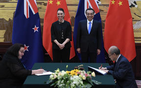 New Zealand Prime Minister Jacinda Ardern and Chinese Premier Li Keqiang during a signing ceremony in Beijing.