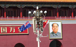 China and New Zealand flags in front of the Tian'anmen Rostrum in Beijing.