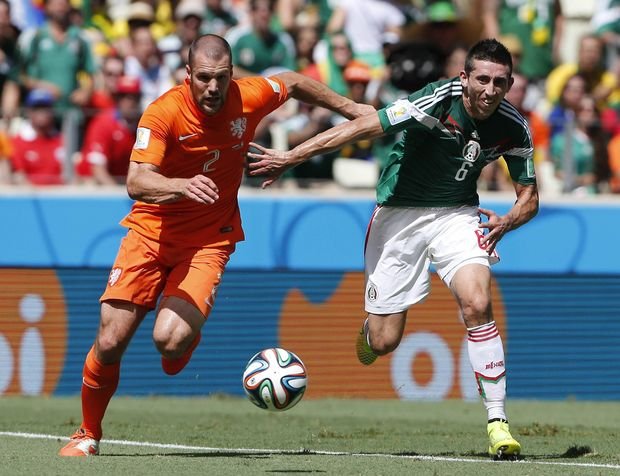 The Netherlands and Costa Rica are through to the quarter-finals of the football world cup.