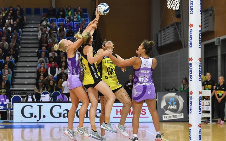 Stars Charlee Hodges takes a shot at goal with team mate Maia Wilson with Pulse's captain Katrina Rore and Sulu Fitzpatrick during the ANZ Premiership netball match.
