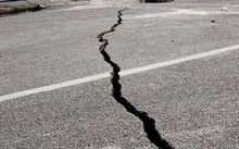 Crack in road after Christchurch earthquake.