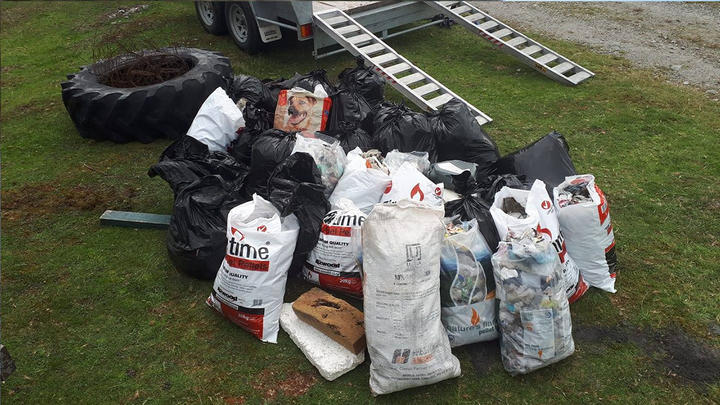 Bags filled with litter after volunteers helped with a cleanup today.