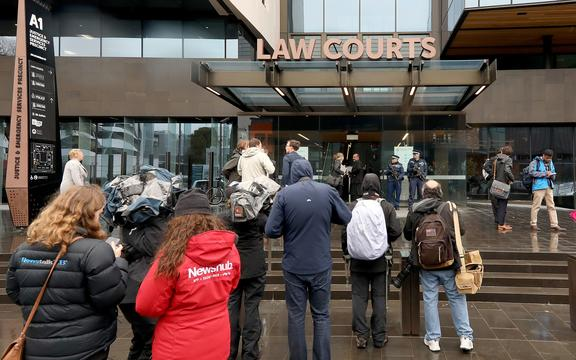 Journalists gather outside the Christchurch District Court ahead of alleged gunman Brenton Tarrant's appearance for his hearing via audio-visual link from a maximum-security prison in Auckland.
