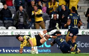 Ardie Savea of the Hurricanes scores a try against the Highlanders