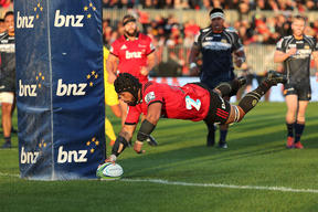 Jordan Taufua of the Crusaders dives over to score a try. against the ACT Brumbies.