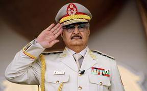 Khalifa Haftar salutes during a military parade in the eastern city of Benghazi.