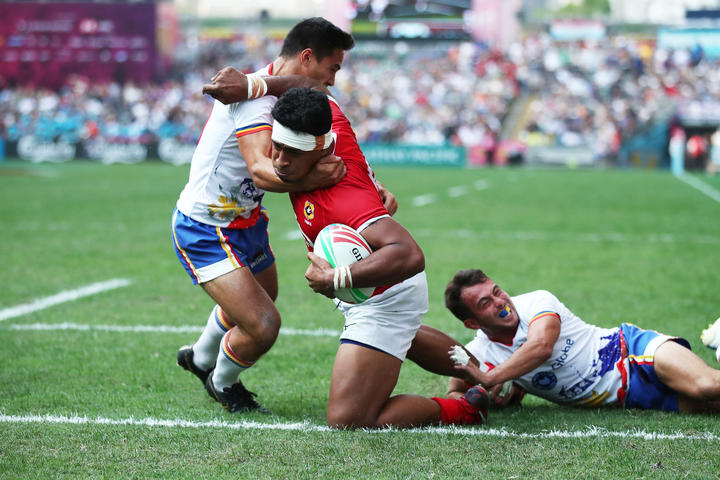 Tonga's Josh Moala-Liava'a charges through the Philippines defence during the World Series Qualifier in Hong Kong.