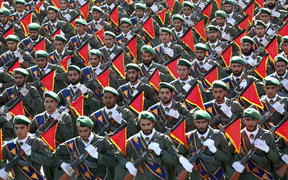 Iran's Revolutionary Guard troops march in a military parade marking the 36th anniversary of Iraq's 1980 invasion of Iran in 2016.