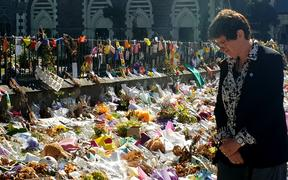 UN deputy high commissioner for human rights Kate Gilmore at the wall of flower tributes offered to victims of the Christchurch terror attacks.
