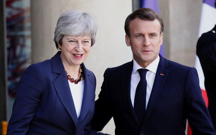 French President Emmanuel Macron and British Prime Minister Theresa May at the Elysee Palace in Paris Tuesday, April 9, 2019.