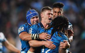Ma'a Nonu celebrates with team mates after scoring a try for the Blues