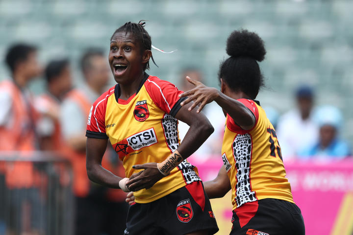 Papua New Guinea's Alice Alois celebrates a try against Scotland during the Women's World Sevens Series Qualifier in Hong Kong