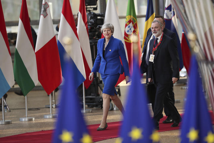 British Prime Minister Theresa May, left, arrives for an EU summit at the Europa building in Brussels, Wednesday, April 10, 2019. European Union leaders meet Wednesday in Brussels for an emergency summit to discuss a new Brexit extension. (AP Photo/Francisco Seco)
