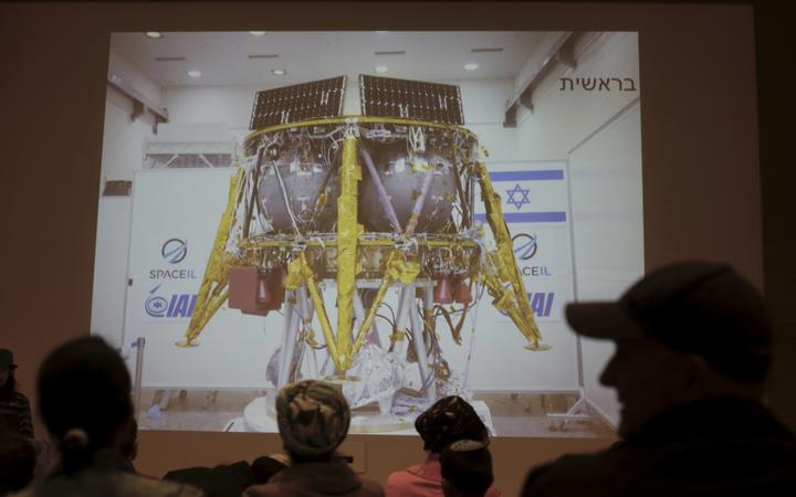 People watch the live broadcast of the SpaceIL spacecraft as it lost contact with Earth in Netanya, Israel.