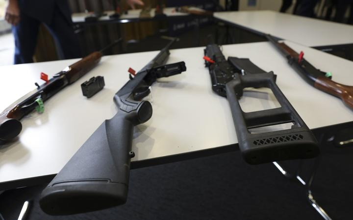A selection of firearms which are now prohibited, on display to media at a police press conference