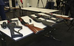A selection of firearms which are now prohibited, on display to media at a police press conference.