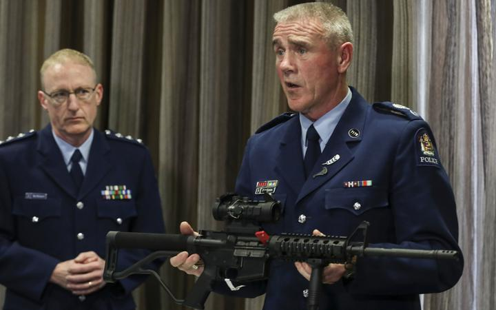 Senior Sergeant Paddy Hannon shows media a Norinco-5-point-56, a mock of the M16 rifle, which is now illegal.