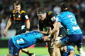 Chiefs captain Brodie Retallick goes on the charge against the Blues.
