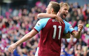 13th April 2019, Turf Moor, Burnley, England; EPL Premier League football, Burnley versus Cardiff City; Chis Wood of Burnley is hugged by Charlie Taylor of Burnley  after he scores with a header in the 90+2 minute to make it 2-0