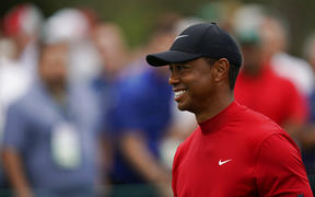 Tiger Woods smiles as he walks off the seventh tee during the final round for the Masters golf tournament, Sunday, April 14, 2019, in Augusta, Ga.