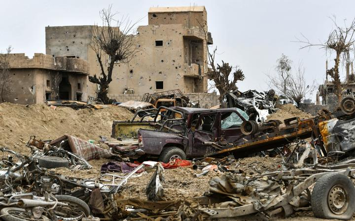 Destroyed vehicles and damaged buildings in the village of Baghouz in Syria's eastern Deir Ezzor province near the Iraqi border.
