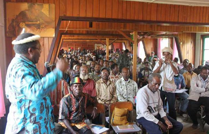 Neles Tebay leads a public consultation to build support for dialogue, in Enarotali , Papua, in 2010.