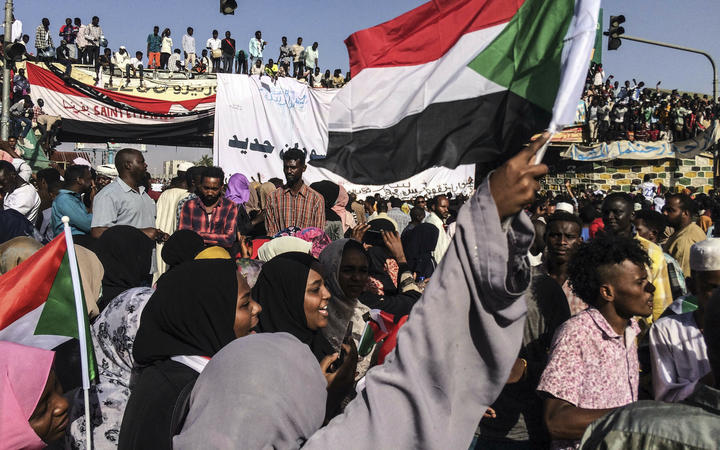 Demonstrators outside the army headquarters in the Sudanese capital Khartoum demand a civilian body to lead the transition to democracy.