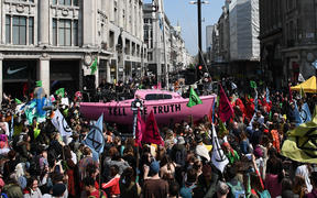 Environmental protesters from the Extinction Rebellion group block the junction of Oxford Street and Regent Street in London on April 15, 2019.