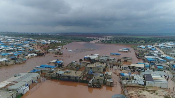 An aerial view of a refugee camp flooded after heavy rain on December 27, 2018 in Idlib, Syria. Tens of thousands of Syrian refugees in camps near the Turkish border are struggling to survive harsh winter conditions.