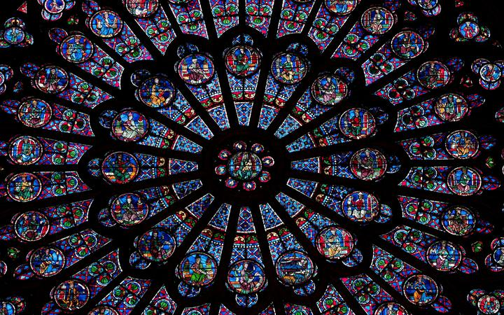 Detail of the north transept rose window in Notre Dame de Paris.