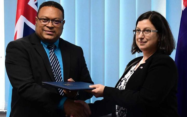 The permanent secretary of Fiji's Ministry of Defence, Manasa Lesuma, with the assistant secretary of Australia's Department of Defence, Sue Bodell.