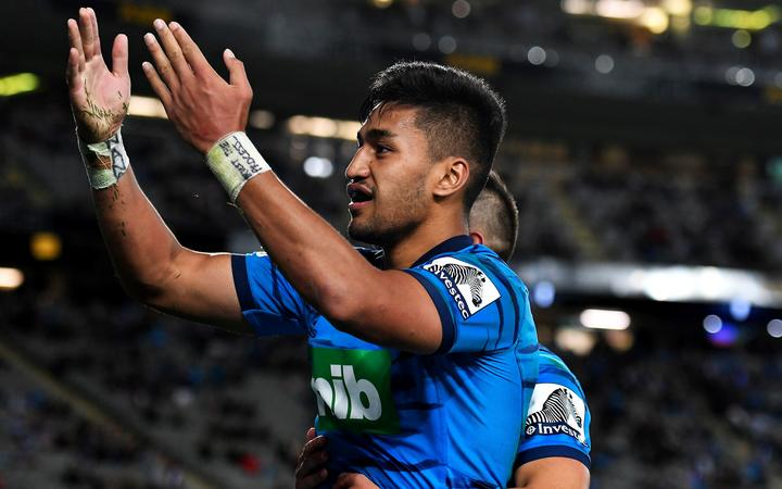 Rieko Ioane celebrates yet another try for the Blues.