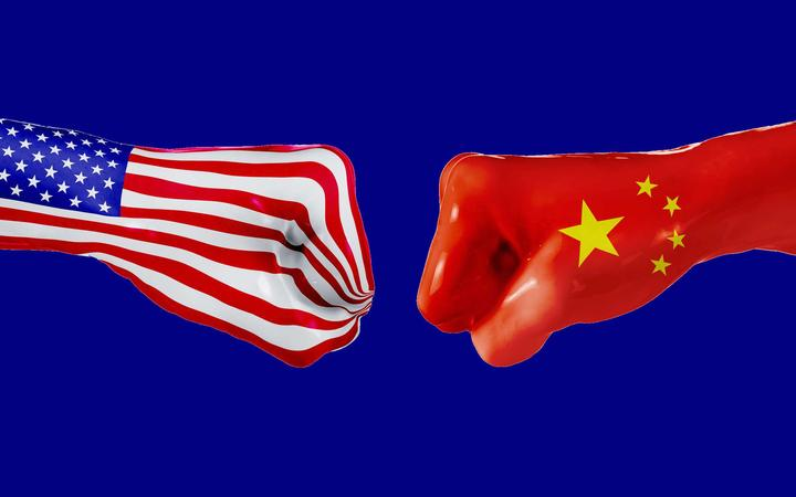 USA and China flag on fisted hands.