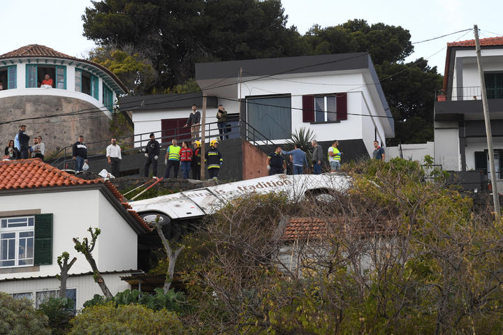 The wreckage of the tourist bus that crashed in Caniço, on the Portuguese island of Madeira.