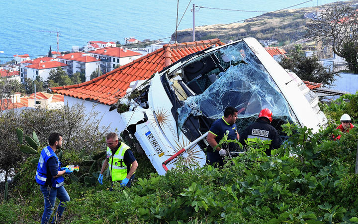 The wreckage of a tourist bus that crashed in Caniço, on the Portuguese island of Madeira.