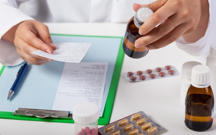 Horizontal view of pharmacist working in pharmacy