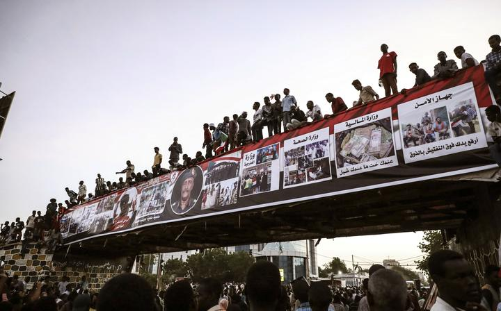 Sudanese protesters chant slogans during a rally outside the army headquarters in Sudan's capital Khartoum on Saturday, April 20, 2019.
