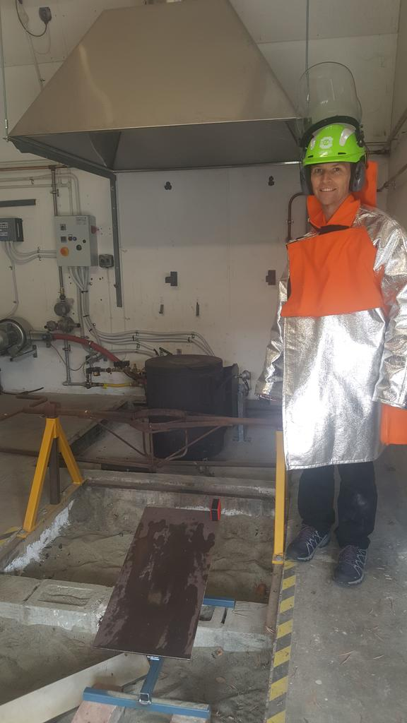 PhD student Dale Cusack wearing a kevlar outfit to protect him from extremely high temepratures in the Lava Lab.