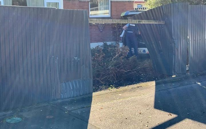 Police car crashed through a fence into a Herbert Street residents front lawn.