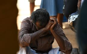 A relative of a Sri Lankan victim of an explosion at a church weeps outside a hospital in Batticaloa in eastern Sri Lanka.
